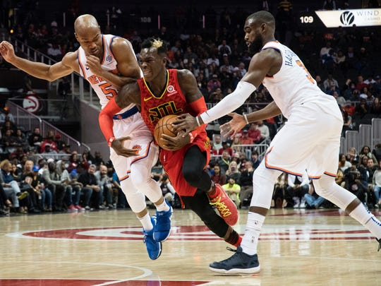 Atlanta Hawks guard Dennis Schroder, of Germany, tries