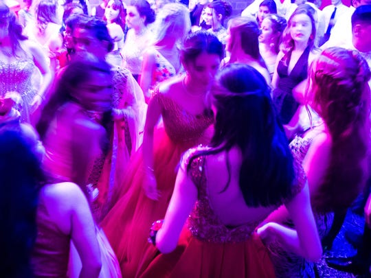 The dance floor a swirl of color and motion at the Signature School prom held at Party Central in downtown Evansville Saturday, April 14, 2018.