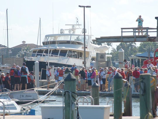 Part of the group of about 125 people gather on a dock at Rose Marina for Marco's record attempt contribution to the wearing of lifejackets at one time.