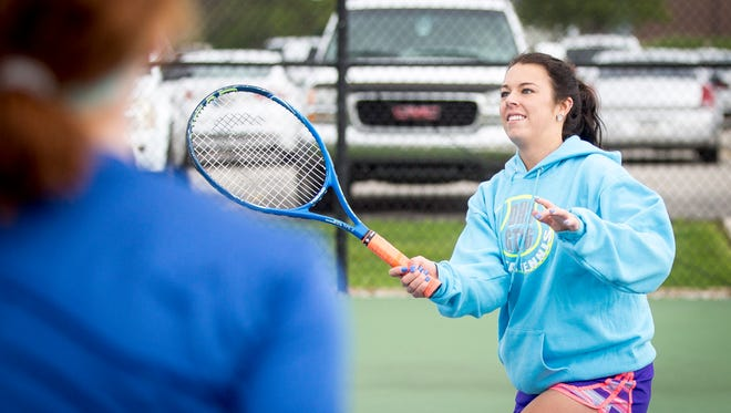 Haleigh Criswell, a Delta tennis player, practices with her team on Monday before the Smash Cancer match against Yorktown on Tuesday. Criswell will be playing for her dad, who was diagnosed with pancreatic cancer in March.