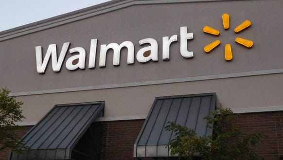 The sign at Walmart's East Asheville store glows in
