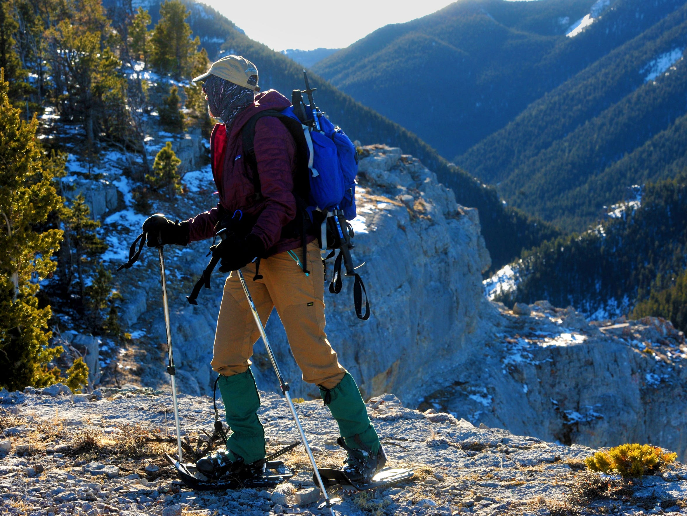 Laurie Lohrer of Lewistown walks along south-facing cliff absent of snow while on a snowshoeing hike in the Big Snowy Mountains Wilderness Study Area in the Lewis and Clark National Forest near Lewistown recently.
