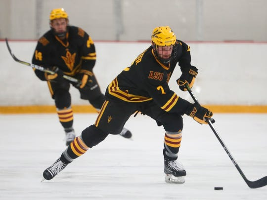 ASU's Johnny Walker (7) skates up the ice against UMass-Lowell