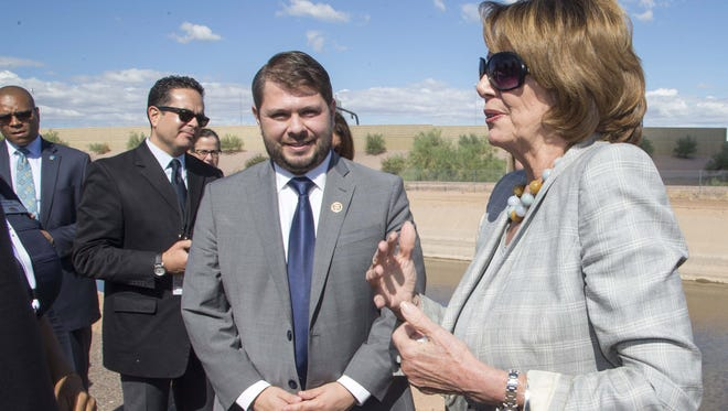 House Minority Leader Nancy Pelosi is calling for more investment in infrastructure, such as a $10 million biking and pedestrian project along Phoenix canals.