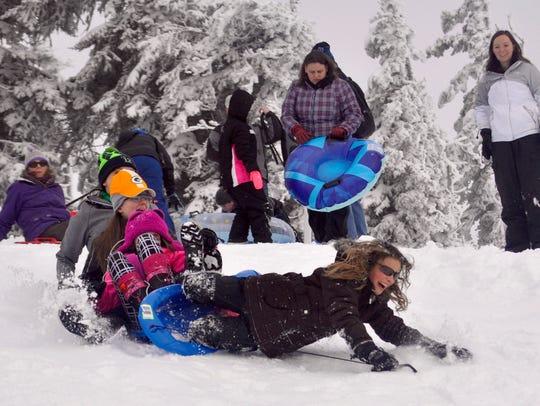 Sledders wipeout at Hurricane Ridge's family sledding