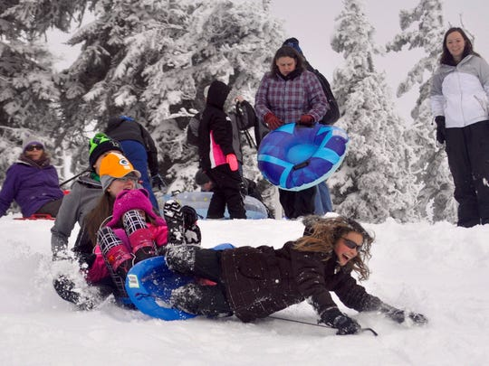 Sledders wipeout at Hurricane Ridge's family sledding