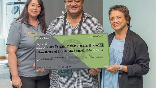 Bank of Guam is a sponsor for the Golden Anniversary of Malesso Fiestan Tasi. Pictured from left:Charmaine Chiguina, Bank of Guam Malesso Branch Acting Branch Manager, Ernest Chargualaf, Malesso Mayor, Lou A. Leon Guerrero, Bank of Guam President, Board Chair and Chief Executive Officer.
