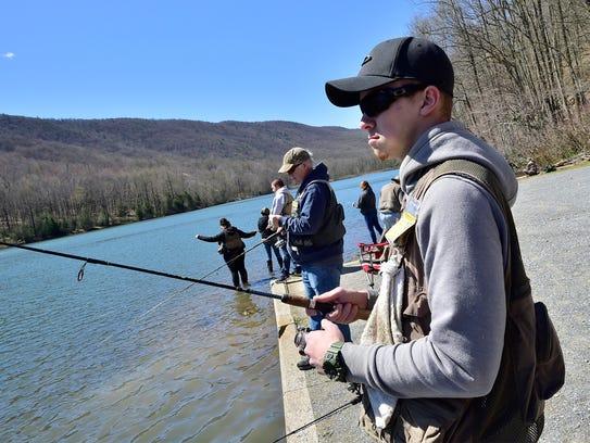 Shane Nenninger, Shippensburg, casts his fishing line