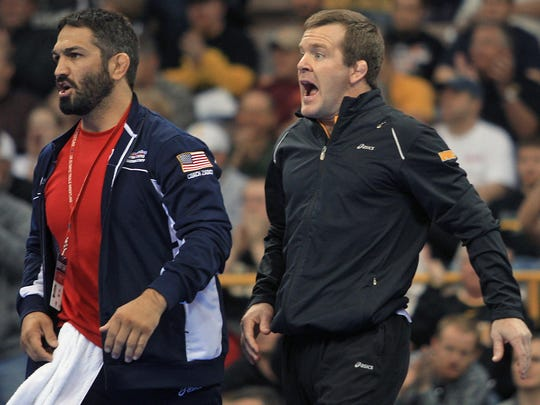 Bill Zadick, left, and Terry Brands, right, yell for support for Zadick's brother, Mike, during a 2012 wrestling trials match with Logan Strieber.
