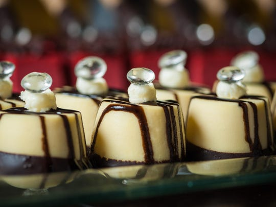 For the Nov. 5 Fantasies in Chocolate gala, mini cheesecakes feature chocolate striping and sugar diamonds.
