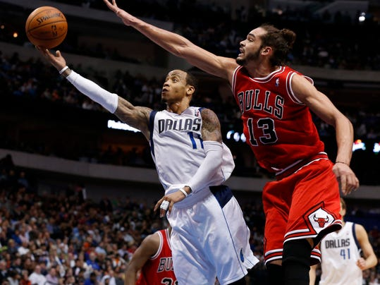 Chicago Bulls center Joakim Noah (13) reaches out to try to block a shot by Dallas Mavericks guard Monta Ellis (11) during the first half of an NBA basketball game on Friday, Feb. 28, 2014, in Dallas. (AP Photo/John F. Rhodes)