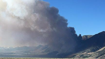 Smoke billows from the Marina Fire on Friday near Lee Vining, Calif.