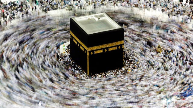 In this picture taken with a slow shutter speed, far smaller crowds than usual of Muslim pilgrims circumambulate the Kaaba, the cubic building at the Grand Mosque, in the Muslim holy city of Mecca, Saudi Arabia on Wednesday. The coronavirus outbreak disrupted Islamic worship in the Middle East as Saudi Arabia on Wednesday banned its citizens and other residents of the kingdom from performing the pilgrimage in Mecca, while Iran canceled Friday prayers in major cities.