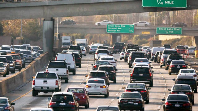 This Dec. 12, 2018 file photo shows traffic on the Hollywood Freeway in Los Angeles. The Trump administration is rolling back tough Obama-era mileage standards and gutting one of the United States' biggest efforts to slow climate change. The administration released its relaxed mileage rules Tuesday.