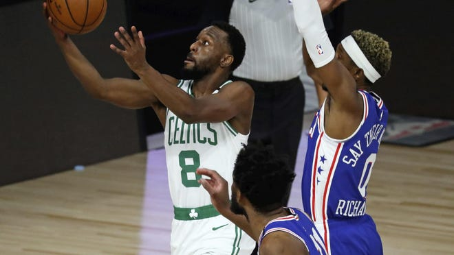 Celtics guard Kemba Walker, who finished with 24 points and eight rebounds, goes in for a layup against 76ers guard Josh Richardson during the first half of Game 3 in their first-round playoff series on Friday night.
