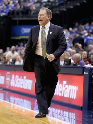 Tom Izzo the head coach of the Michigan State Spartans gives instructions to his team during the game against the Duke Blue Devils in the State Farm Champions Classic at Bankers Life Fieldhouse on November 18, 2014 in Indianapolis, Indiana.