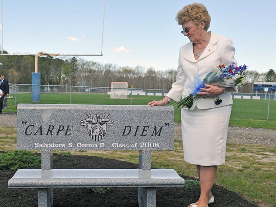 Trudy Corma touches a bench that was dedicated in the memory of her son, 1st Lt. Salvatore S. Corma II,