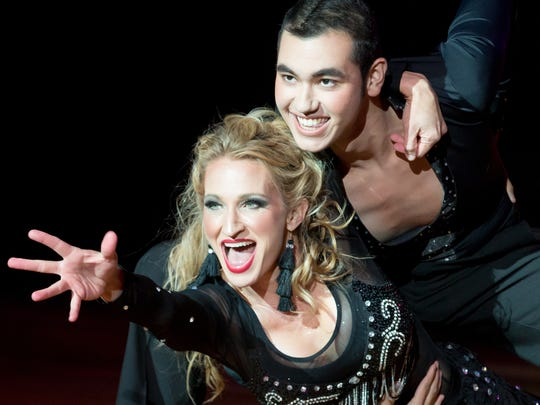 Katy Petermeier and Manny Carmona win the first-place Mirror Ball trophies on Sunday, October 15, 2017, during the 10th season of Look Who's Dancing! at New Mexico State University's Pan American Center. Funding from the event benefits the university's dance teams.