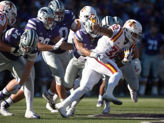 Iowa State Cyclones running back David Montgomery (32) is tackled by Kansas State Wildcats defensive back Cre Moore (23) during first-quarter action at Bill Snyder Family Stadium.