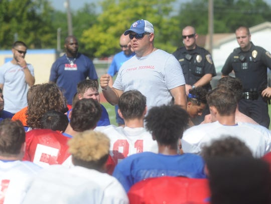 Cooper football coach Todd Moebes talks to his team