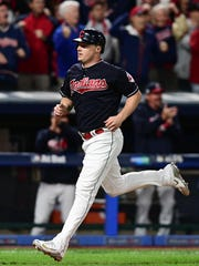 Cleveland Indians' Jay Bruce comes home to score on