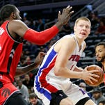 Oct 19, 2016; Auburn Hills, MI, USA; Detroit Pistons forward Henry Ellenson gets defended by Toronto Raptors forward Patrick Patterson during the third quarter at The Palace of Auburn Hills.