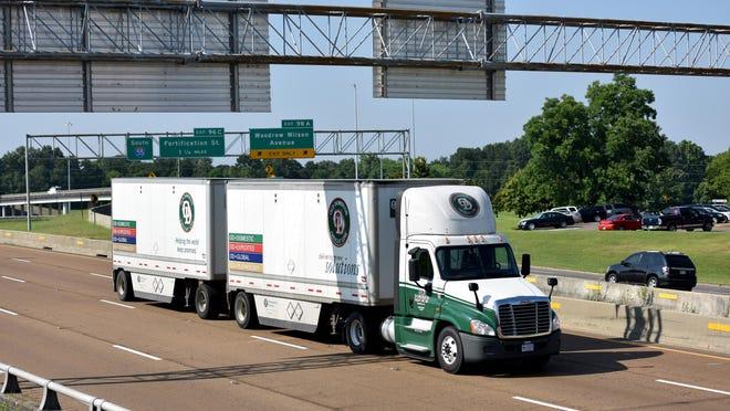 A dual trailer eighteen wheel truck heads north on I-55 near the Woodrow Wilson exit in Jackson.