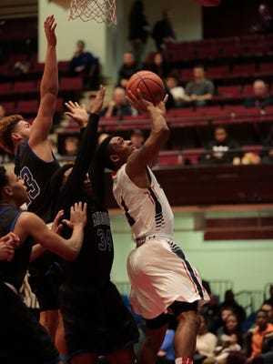 Stepinac's Kobe Miranda (1) shoots against Middletown in the Slam Dunk Tournament championship game at the Westchester County Center on Dec. 27, 2015.