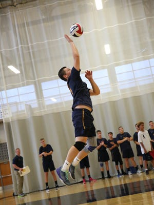 Varsity player Jarod Barnard, of Spencerport High School, jumps to serve the ball to the varsity volleyball team of Gates Chili High School during a game on Saturday, Sept. 10 at Gates Chili.