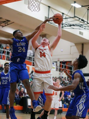 Sprague's Teagan Quitoriano and the Olys fall to Grant 74-72 in the second round of the OSAA Class 6A state playoffs on Friday, March 3, 2017, at Sprague High School.