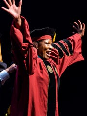 SchMiyah Smith celebrates as she walks across the stage Saturday morning at Ruby Diamond Concert Hall. She was one of 108 FSU College of Medicine students in the Class of 2018