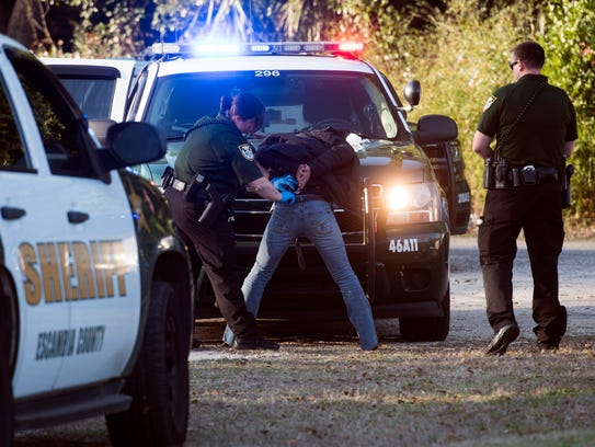 Members of the Escambia County Sheriff's Office High Intensity Patrol unit detain and arrest a suspect on Old Corry Road on Thursday, Feb. 8, 2018.