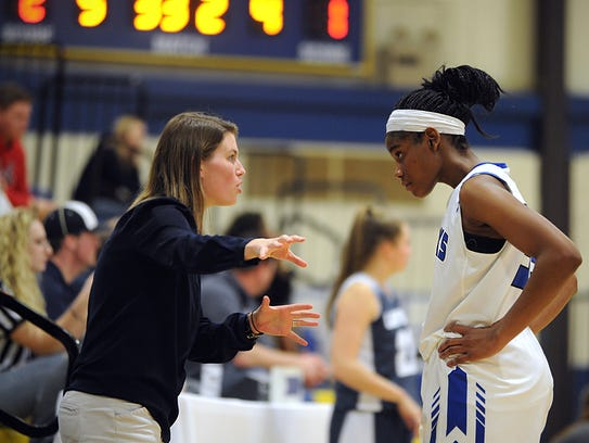 Decatur coach Kate Coates talks with Amya Mumford during