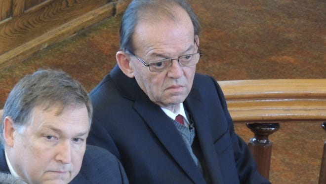 Douglas Every, right, listens Friday as Tioga County Court jurors found him guilty of first-degree manslaughter.  He is joined by his defense lawyers Tom Cline and George Awad, left.