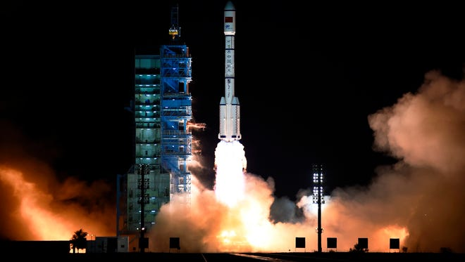 The Long March 7 rocket carrying the Tiangong-2 module blasts off from the Jiuquan Satellite Launch Center. China's increasing presence in space is prompting some in Congress to propose creating a Space Corps to focus solely on space defense.