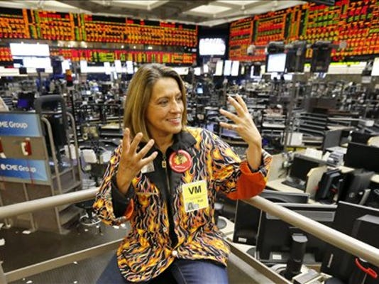 In this Wednesday, July 1, 2015, photo, commodities broker Virginia McGathey talks about the demise of the agricultural futures pits after trading ended for the day at the CME Group in Chicago.