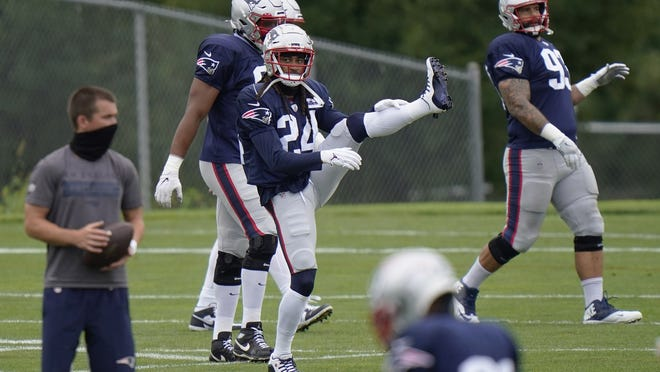 New England's Stephon Gilmore stretches during practice on Monday.