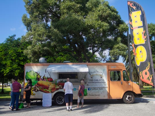 Customers wait for their food from The Nosh Truck on