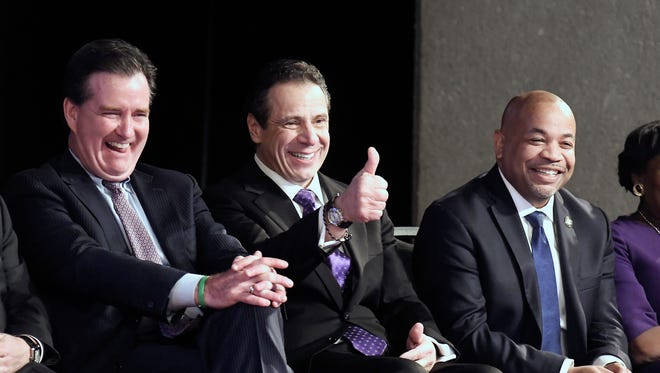 New York Gov. Andrew Cuomo, center, is flanked by Senate Majority Leader John Flanagan, R-Smithtown, left, and Assembly Speaker Carl Heastie, D-Bronx, right, as he waits to deliver his State of the State address last month at the Empire State Plaza Convention Center in Albany.