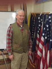 Eric Phelps displays is collection of flags, which