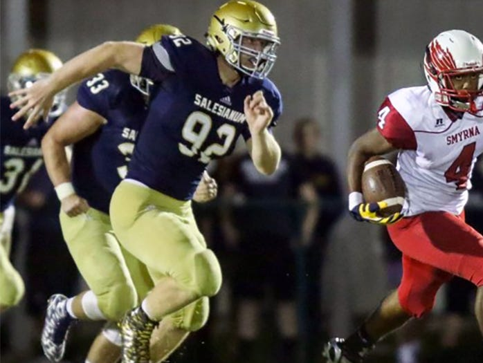 Salesianum's Kyle Cathers (left) pursues Smyrna's Donte Ritchie during the teams' regular-season game on Sept. 25.