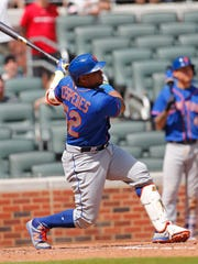 New York Mets left fielder Yoenis Cespedes (52) follows through on a grand slam in the ninth inning of a baseball game against the Atlanta Braves Saturday, June 10, 2017, in Atlanta. It was the first game of a double header.