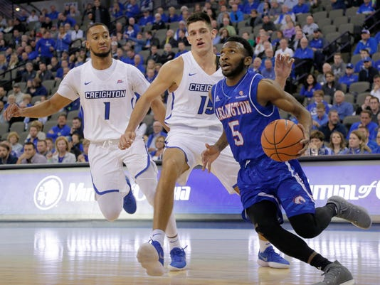 Texas-Arlington's Kaelon Wilson (5) goes to the basket past Creighton's Martin Krampelj (15) and Davion Mintz (1) during the first half of an NCAA college basketball game in Omaha, Neb., Monday, Dec. 18, 2017. (AP Photo/Nati Harnik)