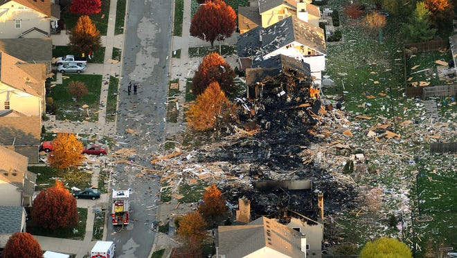 The two homes leveled and numerous neighboring homes damaged from a massive explosion in Indianapolis are shown in this Nov. 11, 2012, file aerial photo.