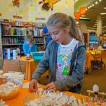 Trulen Hatley, 5, works on building a circuit with help from Barnes and Noble bookstore merchandise manager Melissa Miller during a Mini Maker Faire on Saturday.