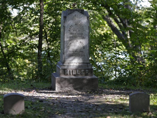 The tombstone of Kate Blood is tucked away in a wooded