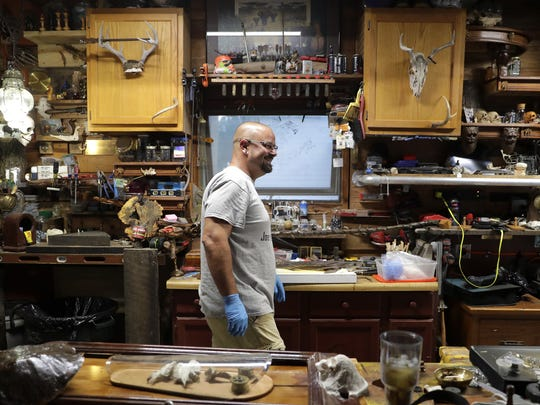 Scott Watzlawick talks with his father Ron Watzlawick (not pictured) about how to display the dogfish shark he is in the process of mummifying at his home in Appleton.