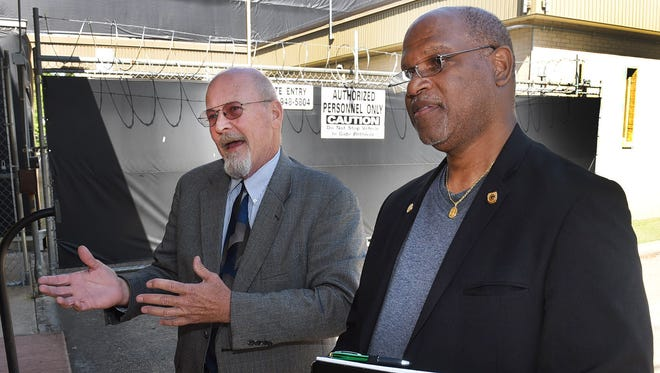 Mayor Reggie Tatum, right, and his attorney, Frank Olivier, talk with reporters outside the Court Annex Building on Thursday, April 5, 2018.