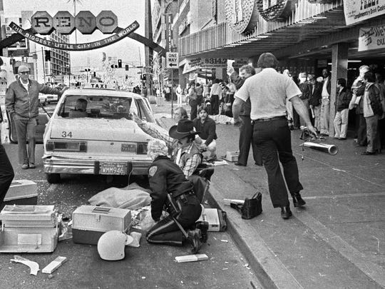 Reno Policewoman Pam Engle tends to one of those injured when Priscilla Ford drove her car down the sidewalks in front of the casinos killing six and injuried 23.  A seventh person died a year later. Photo by Marilyn Newton