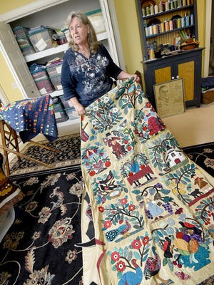 Deb Ramsey discusses one of her quilts she is still working on from her Lexington home on Tuesday.